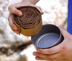 Fire up a tin can for some summer cooking fun. Cut corrugated cardboard into strips that are the same width as the height of the tuna can. A buddy burner (a tuna can, or a can similar in shape, filled with rolled corrugated cardboard and melted paraffin) is the main source of heat for a tin can stove.