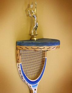 Tennis Racquet Display Shelf: How about making a display shelf from an old tennis racquet? The display shelf looks cool, but the toughest part is that connecting everything without breaking the tennis string.