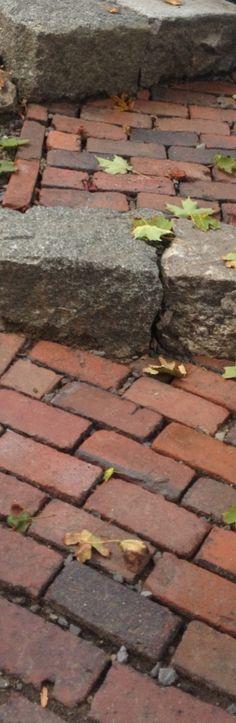 granite risers and brick paths