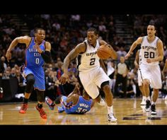 Oklahoma City Thunder v San Antonio Spurs - Game Five SAN ANTONIO, TX - MAY 29: Kawhi Leonard #2 of the San Antonio Spurs and Kevin Durant #35 of the Oklahoma City Thunder go for a loose ball in the first quarter during Game Five of the Western Conference Finals of the 2014 NBA Playoffs at AT&T Center on May 29, 2014 in San Antonio, Texas.