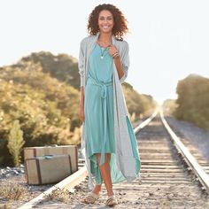 RIVER BEND DRESS--Figure-flattering gathered jersey knit feels as comfortable as your favorite tee. Elastic, tie-waist and hi-lo hem. Modal/spandex. Machine wash. Imported. Exclusive. Sizes XS (2), S (4 to 6), M (8 to 10), L (12 to 14), XL (16). Approx. 44-1/2L.