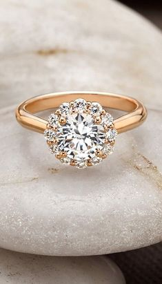 rose gold floral diamond halo ring