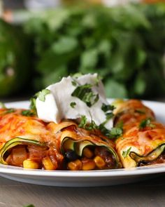 "Zucchini ""enchiladas"" Recipe by Tasty"