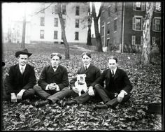 Four men and a dog sit on College Green in autumn, 1890s. Ohio University Archives