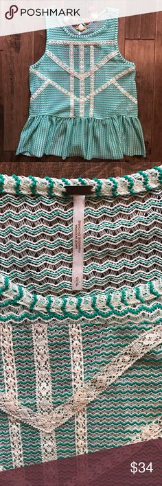 Free People Crochet Tank Free People minty green and off white crochet knit tank with zig zag floral crochet detailing. Peplum hem and partial open back. Fits slightly oversize, might fit medium also but check measurements. Excellent condition. Free People Tops Tank Tops
