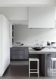 a richly variegated stone countertop introduces another texture to the palette. The stools are by Meijers. Remy Meijers, apartment in the Hague, Netherlands | Remodelista