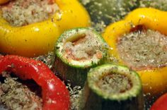 """Dolma – meaning """"stuffed"""" – is a classic Mediterranean dish that consists of vegetables stuffed with a meat and rice mixture. This recipe uses summer squash and bell peppers… Comida Armenia, Armenian Recipes, Mediterranean Dishes, Summer Squash, Recipe Using, Entrees, Zucchini, Sushi, Sausage"""