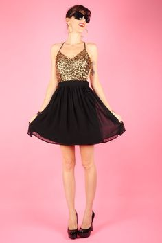 It's the season of glitters! You have anything to wear on your Christmas party yet? We think this dress will definitely make you stand out with the all-sequined top and sexy back.