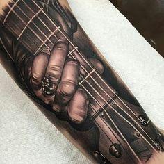 10 Guitar Tattoos That Rock