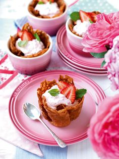 A little basket of crisp buttery biscuit filled with a creamy fresh strawberry mousse topped with strawberries and mint leaves... yum!