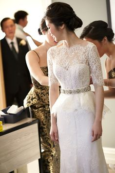 A beautiful bride gets ready in her lace peplum wedding dress at Four Seasons Hotel Sydney. Photo: Bluementhal Photography.
