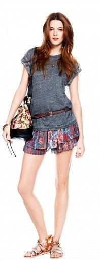 Add an element of fun to a basic gray tee with a layered paisley-print skirt.