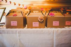 DIY activity boxes / wedding favors for kids from our wedding.  in kraft gable boxes, with mazes, clay, coloring pages, games, etc.
