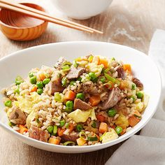 Precubed pork, cooked brown rice, and a mix of frozen veggies cut the cook time in our fried rice recipe. Fresh ginger, garlic, and Chinese five-spice powder bring the flavor to this 20-minute dinner. /