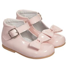 Girls pale pink patent leathershoes by Children's Classics,ideal for both special occasions and day-to-day wear. They havean adorable bow on the front with an adjustable buckle strap. They have a leather lining and padded instep, with a rubber sole.