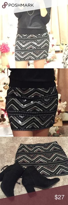 Express Sequin mini Express mini skirt with sequin detail. Worn once, no damages at all. Great for the holidays. 14 inch length. Express Skirts Mini