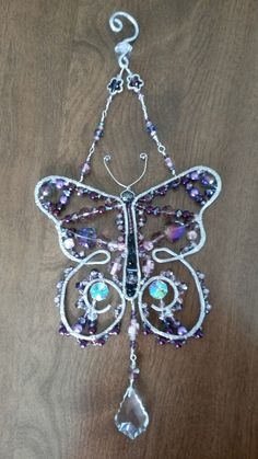 Wire wrapped beaded butterfly sun catcher with crystals.