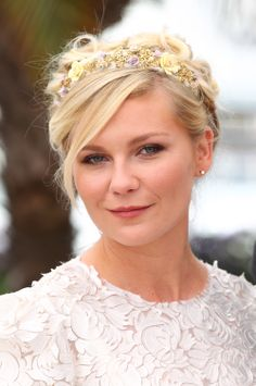 At the 2012 Cannes Film Festival, Kirsten's floral headband atop a curled up 'do made for a whimsical look.