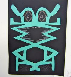 Name Monsters. Incorporates symmetry with an art activity. Love this idea.