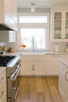 Kitchen. Kitchen Ideas. Kitchen with light stained hardwood floors, seafoam paint color and off-white cabinets. #Kitchen #KitchenIdeas #KitchenDesign    Four Chairs Furniture.
