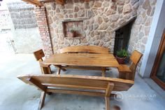 Mediterranean home stone wall interior & nice wooden table settings. http://www.casademar.com