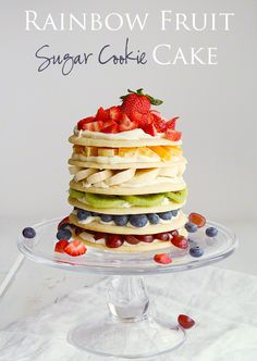 I love how stunning the white frosted rainbow cakes are out there in blog world, but the amount of food coloring in the layers makes me nauseous.  This is a pretty and healthier, yet still COLORFUL,  alternative to it for a rainbow party!  ||  Delicious Cookie Cake, perfect for all celebrations!  via i am baker