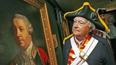 Rev. Richard Walsh of Upper Tantallon, dressed as a eighteenth century Royal Artillery bombardier, looks over a painting of Edward Cornwallis at the Art Gallery of Nova Scotia in 2006. (PETER PARSONS / Staff / File)