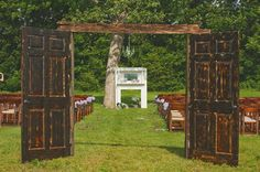 Two open doors lead to the seating area & a fire place is the alter backdrop - ceremony - outdoor wedding