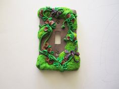 polymer clay light switch cover by DawnsClayFantasy on Etsy