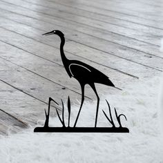 This beautiful Wrought Iron Wall Art piece features a Heron silhouette in a striking flat black baked-on powder coating that will last for many years.  This metal art work will accent any home decor - from a rustic north woods look to western, country or contemporary. Wrought Iron Wall Art, Metal Artwork, Powder Coating, Heron, Art Work, Woods, Art Pieces, Wall Decor, Silhouette
