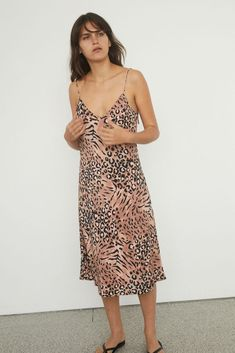 Paige Denim's 'Cicely' silk slip dress is your go-to dress when it comes to vacation dress. Cut from glossy silk-satin, this leopard printed dress has a figure-skimming fit and pin-thin shoulder straps. Wear it over a T-shirt and sneakers during the day, swapping them out for mules and a clutch come evening. Cold Shoulder Dress, Shoulder Straps, Silk Slip, Vacation Dresses, Paige Denim, Size Model, Satin, How To Wear, Shirts