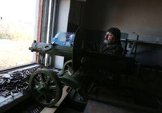 Ukrainian volunteer refilling his WW1 Maxim gun after intense fire-fight Peski village Ukraine 2014 [2048x1433]