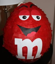 M&M Candy Pinata    This listing is for the pinata and $5 rush fee. This does not include shipping as you will pick the pinata up.    What child does not like candy? This is a perfect addition to your candy theme party.    The M&M is decorated in red, complete with a face, but could be changed to your favorite color. The M&M stand about 15 tall. This is a traditional hit pinata.      WE NOW HAVE FACEBOOK!!! Please LIKE us to keep up with our new designs, products, and promotions…