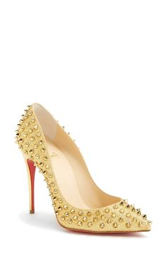 Red bottoms and gold studs.