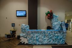 Use crinkled white paper painted blue to decorate your VBS information/welcome area at #OperationArctic, #vbs2017