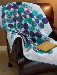 "Stitch up a fun circle quilt--cut your fabric scraps into 4"" Circles then stitch to a solid background fabric."
