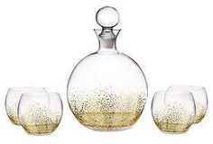 Perfect for special occasions yet durable enough for everyday use, this set includes a round decanter and four glasses, each finished with speckled golden embellishments