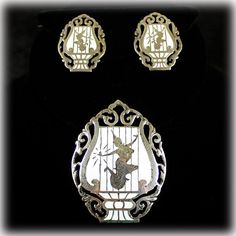 Mid Century Siam Sterling Lyre Brooch & Earrings. Lyre design featuring the Goddess of Lightning.