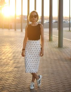 Pencil skirts need not be confined to office attire; worn with sneakers, they make for a sophisticated daytime look.Click through to shop the look.
