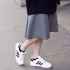 This is the perfect example of how to dress down a classic maxi skirt. Style it with an oversized sweater and a pair of sneakers. These Vans are perfect for dressing down any outfit: http://asos.to/1nBKl7Y