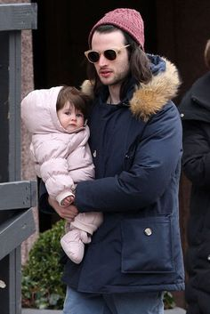 Dad on Duty: Tom Sturridge held onto his daughter Marlowe during a Sunday walk in NYC.
