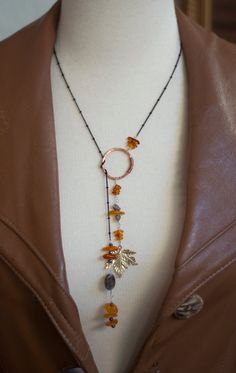 .Adjustable necklaces by looping through center - totally looks like something my friend Kai would wear.