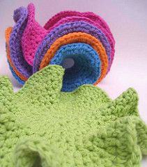 Practical Hyperbolic Dishcloth These use about an ounce of yarn each, so they're very economical. They're awesome to use because they do cool flippy foldy things in your hand (without being uncontrollable at all) FREE crochet pattern