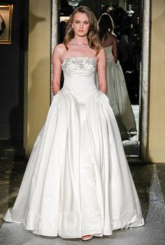 06c37113625 See pictures of Oleg Cassini s Spring 2016 wedding dress collection.