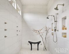A huge (18-by-7-foot!) shower is awash in dolomite marble on the walls and in the custom herringbone pattern on the floor and ceiling. It's equipped with two separate showerheads and a total of six high-power jet sprays that can be positioned in any direction, along with two steam generators and heated floors. Heated Floors, Bath Inspiration, Acrylic Chandelier, Glamorous Bathroom, Shower Heads, Dining Room Inspiration, Natural Stone Wall, Shower Wall, Room Inspiration