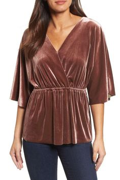 Halogen Faux Wrap Velvet Top | We're crushing on velvet. The holiday season is upon us, and you know what that means: It's time to look the part. There's nothing quite as festive as a little velvet this time of year and these budget-friendly picks (all under $75) won't break the bank either. The beautiful fabric in holiday colors like deep red, blush pink, and bright gold are elegant but comfortable enough to wear all day. Whatever you do, don't wait too long to snag these classic picks.