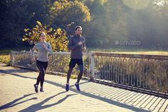 happy couple running outdoors by dolgachov on PhotoDune. fitness, sport, people and jogging concept ¨C happy couple running outdoors Sports Couples, Couple Running, Fitness Sport, Jogging, Outdoors, Concept, Stock Photos, Couple Photos, Board
