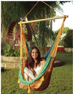 "Multi-colored with warm, summer hues and more. This hammock chair draws attention to its elegant design. Composed of 80% cotton and 20% nylon, the chair bed is constructed of woven cotton making it very breathable and soft, so you can sit or stretch out comfortably. The chair bed is connected by woven nylon for extra strength and durability outdoors. Specs  Spread Bar: 3'3"" wide, Carrying Capacity: 330 lbs, 80% Cotton and 20% Nylon  ,Handwoven $58.95 + shipping"