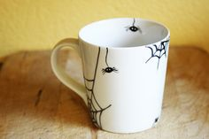 This is just so perfect for this month!  Halloween Hand Painted Ceramic Mug Tea Cup With by SylwiaGlassArt
