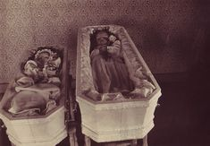 Tragic. A real photo postcard showing two sisters laid out in matching coffins. An inked inscription verso in a fine period hand identifies the girls as Claudia Severine Groth / Born Sept. 30, 1908 / Died Feb. 20, 1911 and Millie Cecelia / Born Dec. 25, 1910 / Died Feb. 21, 1911. Underneath this the inscription identifies their mother, Mrs E. O. Groth / Enderlin / N. Dak.